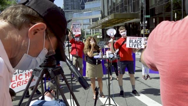 state nurses association. labor unions workers rallied outside the trump international hotel & tower at columbus circle in manhattan, new york city... - social justice concept bildbanksvideor och videomaterial från bakom kulisserna
