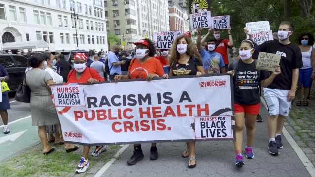 state nurses association labor unions workers rallied outside the trump international hotel tower at columbus circle in manhattan new york city to... - social justice concept stock videos & royalty-free footage