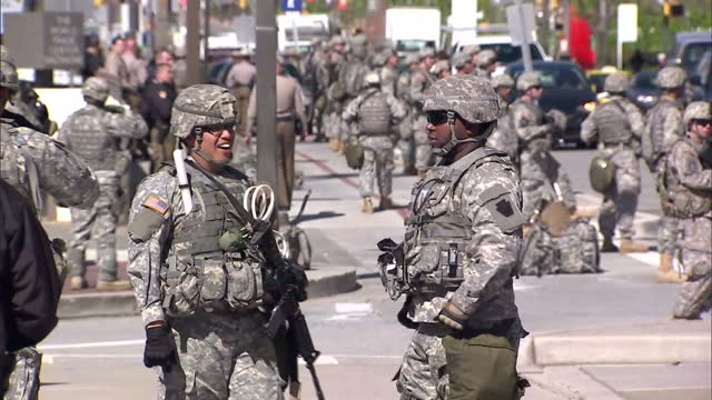 state of emergency declared in baltimore shows exterior shots national guard personnel lined up along road on april 28 2015 in baltimore maryland - national guard stock videos and b-roll footage