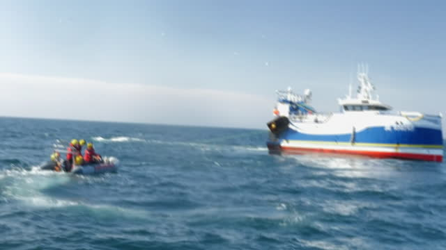 state of emergency has been declared in the english channel over fishing trawlers. shows: greenpeace crew intercepting french fishing trawler 'fly... - report produced segment stock videos & royalty-free footage