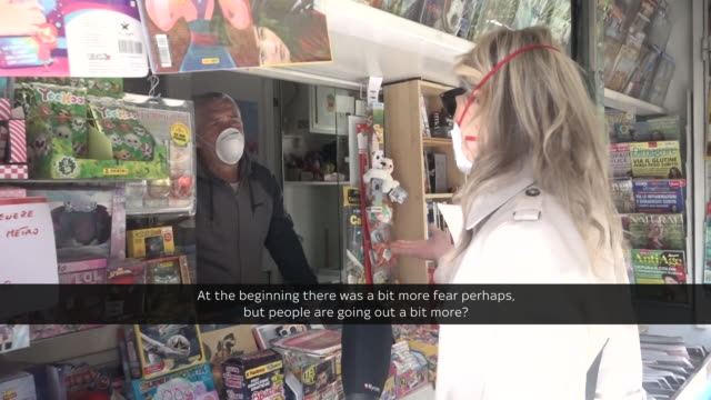 state of lockdown becomming the 'new normal' in rome shows people walking in streets wearing face masks and gloves residents on balconies supermarket... - lockdown video stock e b–roll