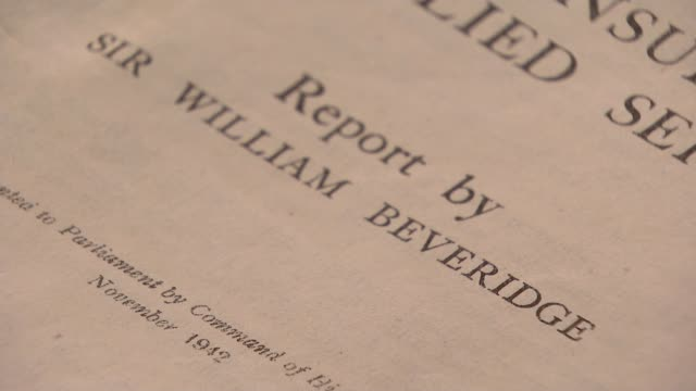 years since beveridge report; london: richmond: kew: int close shots copy of the beveridge report chris day interview sot cutaways report and reporter - report produced segment stock videos & royalty-free footage