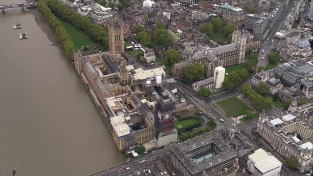 state opening of parliament: aerials of queen's journey to houses of parliament; england: london: westminster: ext air views / aerials houses of... - big ben stock videos & royalty-free footage