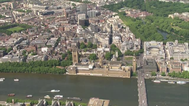 air views of procession from buckingham palace to houses of parliament air views houses of parliament river thames london eye - state opening of uk parliament stock videos & royalty-free footage