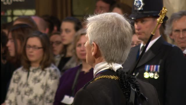 black rod and mps processing through lobby england london palace of westminster int police lined up / mps waiting / black rod waiting / black rod... - state opening of uk parliament stock videos & royalty-free footage