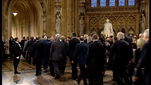 black rod summoning mps to hear the queen's speech mps following the speaker to the house of lords chamber - the queen's speech state opening of uk parliament stock-videos und b-roll-filmmaterial