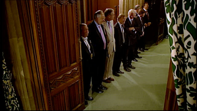 black rod summons mps england london palace of westminster int men standing in corridor as commons official along and says close the west door one... - the queen's speech state opening of uk parliament bildbanksvideor och videomaterial från bakom kulisserna