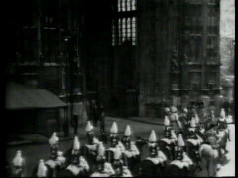 state opening of parliament ext more of queen waving from carriage royal procession entering houses of parliament royal carriage along through gates... - personal land vehicle stock videos & royalty-free footage