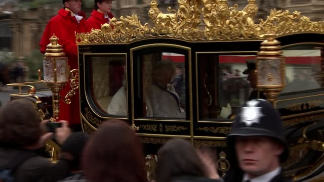 politicians attend queen's speech ceremony england london westminster ext horses and carriage carrying queen elizabeth ii prince charles prince of... - principe carlo principe del galles video stock e b–roll