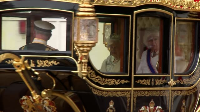 politicians attend queen's speech ceremony england london westminster ext horses and carriage carrying queen elizabeth ii prince charles prince of... - tourism stock videos & royalty-free footage