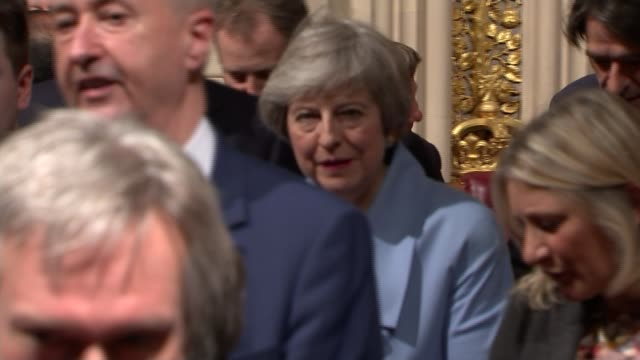 politicians attend queen's speech ceremony england london palace of westminster int theresa may mp filing through commons lobby with other mps for... - opening stock videos & royalty-free footage