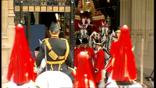 queen arrives at house of lords soldiers on horseback in various uniforms at entrance to house of lords - britisches parlament stock-videos und b-roll-filmmaterial