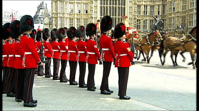 queen arrving at westminster england london ext queen's guard soldiers standing to attention as queen elizabeth ii and prince philip along in irish... - headdress stock videos & royalty-free footage