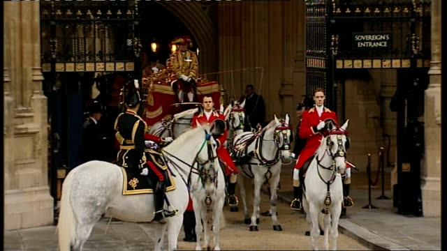queen leaves parliament england london westminster ext prince philip and queen elizabeth ii boarding carriage after the queen's speech / queen's... - the queen's speech state opening of uk parliament stock-videos und b-roll-filmmaterial