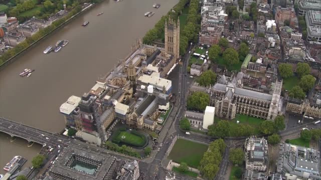 queen's houses of parliament arrival aerials england london westminster houses of parliament victoria tower and big ben clock tower by river thames - victoria tower stock videos & royalty-free footage