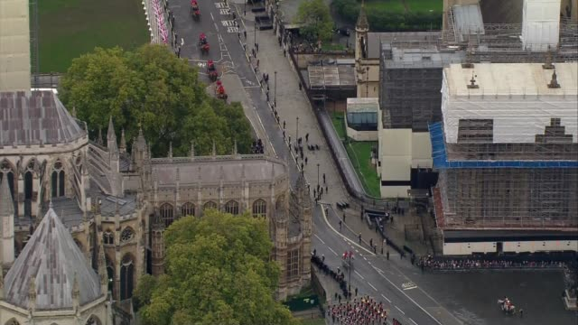 queen's houses of parliament arrival aerials england london westminster escort and carriage followed by king's troop royal horse artillery from... - victoria tower stock videos & royalty-free footage