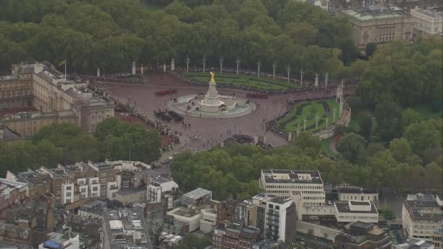 state opening of parliament: queen's houses of parliament arrival aerials; england: london: westminster: ext air views household cavalry mounted... - diamond jubilee stock videos & royalty-free footage