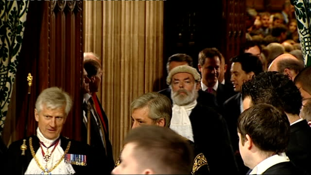queen's speech 2012 david cameron mp and ed miliband mp walk along together though members' lobby as leading mps to house of lords from commons - thronrede britische parlamentseröffnung stock-videos und b-roll-filmmaterial