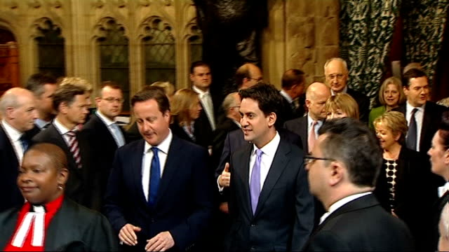 Queen's Speech 2013 David Cameron MP and Ed Miliband MP walking through central lobby followed by other MPs