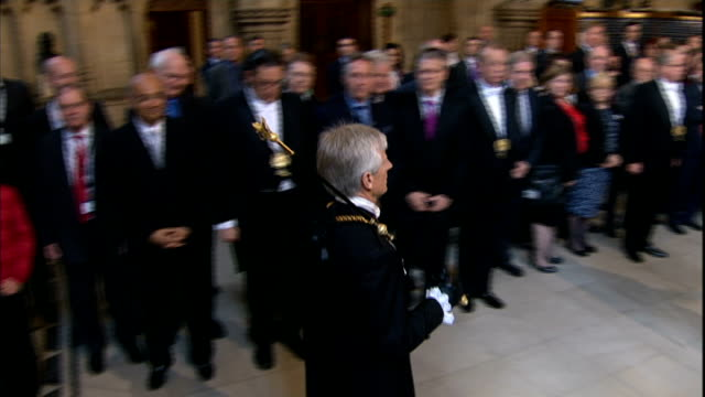 state opening of parliament: queen's speech 2013; house of commons: various shots black rod walking through lobby and banging with staff on closed... - the queen's speech state opening of uk parliament stock videos & royalty-free footage