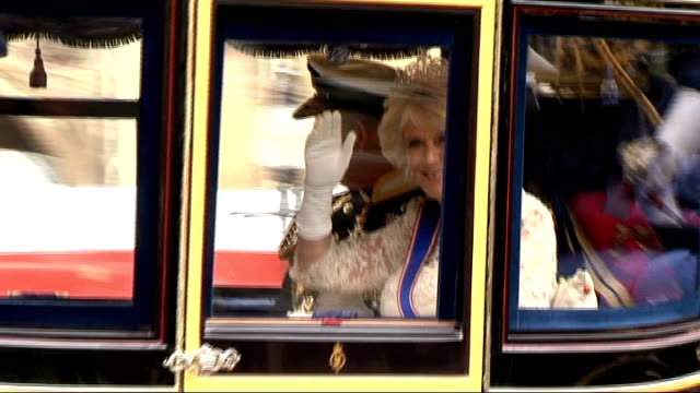 queen's speech 2013 queen and philip along in carriage charles and camilla along in carriage and waving sarah mulley interview sot - camilla duchess of cornwall stock videos and b-roll footage