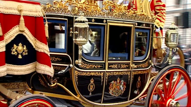 state opening of parliament: queen's speech 2013; queen elizabeth ii and prince phillip, duke of edinburgh along in carriage - the queen's speech state opening of uk parliament stock videos & royalty-free footage