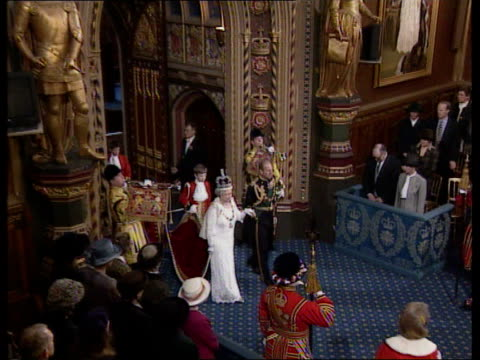 state opening of parliament: queen's speech; england: london: house of lords: int tgv queen elizabeth ii into chamber with prince philip, duke of... - ウェストミンスター宮殿点の映像素材/bロール