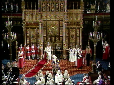 state opening of parliament: queen's speech; england: london: westminster: house of lords: int tms queen elizabeth ii and prince philip seated on... - ウェストミンスター宮殿点の映像素材/bロール