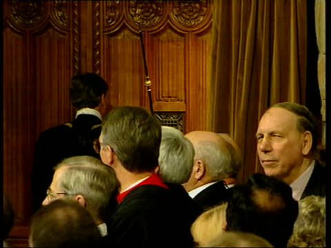 queen's speech pool house of lords queen with philip past lords into chamber house of commons side gv black rod past spectators towards chamber to... - the queen's speech state opening of uk parliament bildbanksvideor och videomaterial från bakom kulisserna