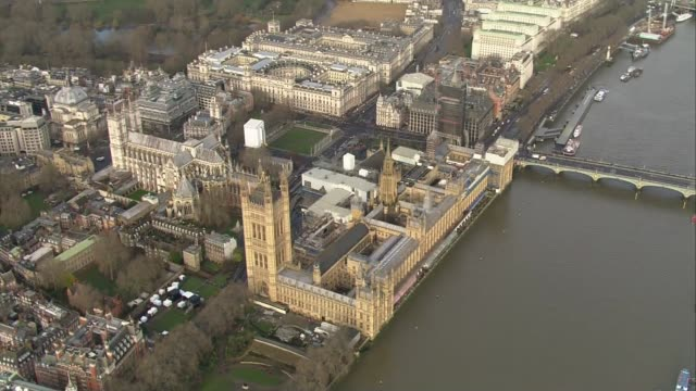 westminster aerials via bbc england london monarch flag on victoria tower / houses of parliament and river thames / - victoria tower stock videos & royalty-free footage