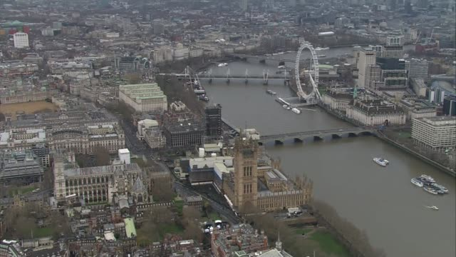 westminster aerials via bbc england london houses of parliament and river thames / union jack on victoria tower / london eye / horse guards parade... - victoria tower stock videos & royalty-free footage