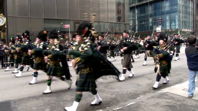 state police bagpipers march down 5th avenue in nyc during the 2015 st. patrick's day parade. - bagpipes stock videos & royalty-free footage