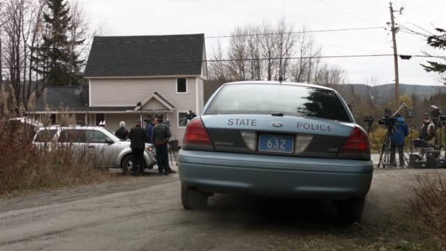 a state police car keeps watch outside of the home of kaci hickox on october 31 2014 in fort kent maine after returning from sierra leone where she... - the morning after stock videos & royalty-free footage