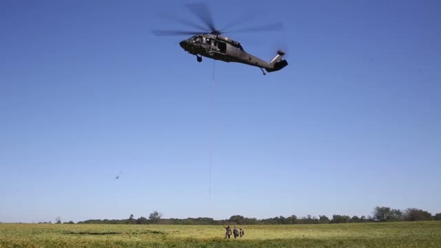A State Trooper with the Kentucky State Police Cannabis Suppression Branch rappels from a National Guard UH60 Blackhawk helicopter in order to seize...