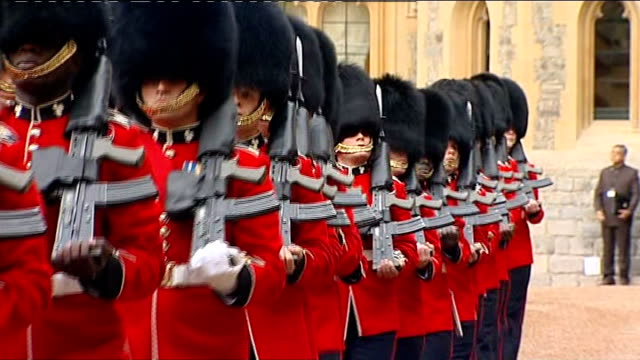 state visit by indian president pratibha patil: march past at windsor castle; royal guards marching past with guns as band plays / queen and pratibha... - ehrengarde stock-videos und b-roll-filmmaterial