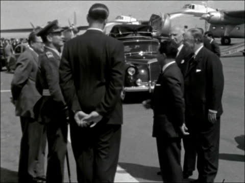stockvideo's en b-roll-footage met state visit by king feisal of iraq: departure from lydd airport; england: lydd airport : ext king feisal ii of iraq out from car and shaking hands... - irak