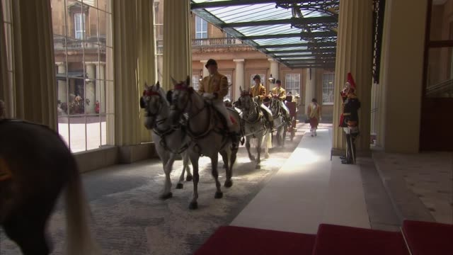 buckingham palace arrival england london buckingham palace ext carriages carrying queen elizabeth ii and prince felipe vi of spain out of carriage on... - philip ii of spain stock videos and b-roll footage