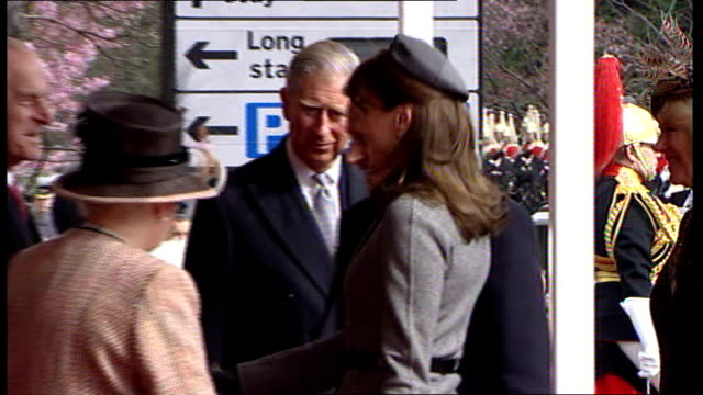 state visit by nicolas sarkozy and his wife carla bruni; berkshire: windsor castle: carla bruni shaking hands with queen , curtseying and shaking... - british royalty stock videos & royalty-free footage