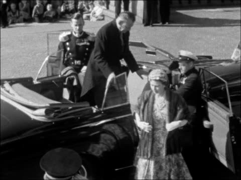 copenhagen car along towards with escort containing king frederik and queen elizabeth ii / car past both wave pan / other car along containing prince... - denmark stock videos & royalty-free footage