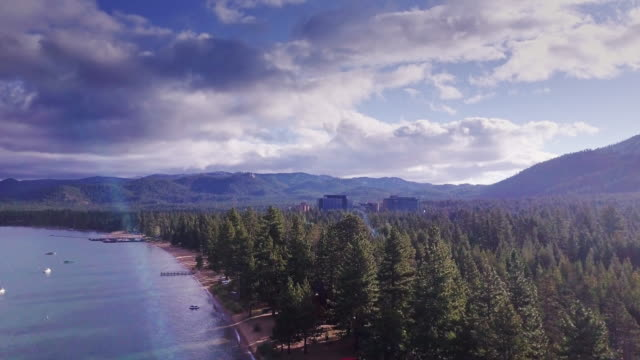 stateline casinos and the shore of lake tahoe - aerial view - californian sierra nevada stock videos and b-roll footage