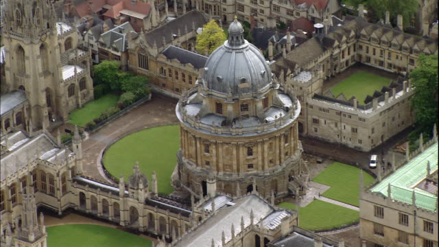 stately gardens surround the domed radcliffe camera in oxford, oxfordshire, england - oxford england stock videos & royalty-free footage
