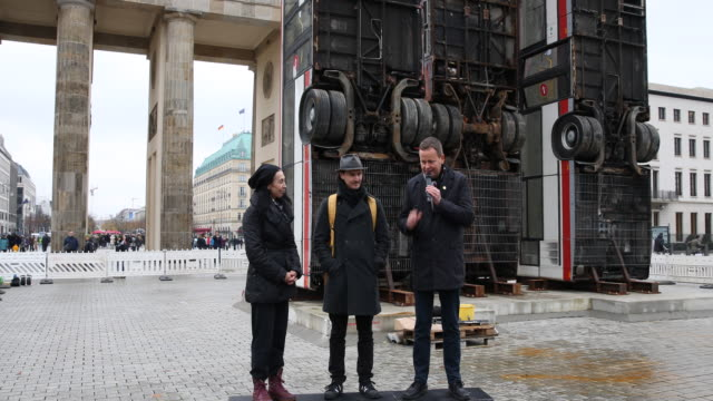 Statement of GermanSyrian artist Manaf Halbouni while attending the installation of his work 'Monument' in front of the Brandenburg Gate on November...