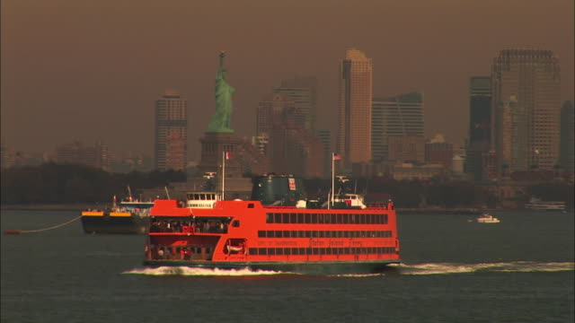 ws staten island ferry cruises by statue of liberty / new york city, new york, usa   - staten island stock videos and b-roll footage