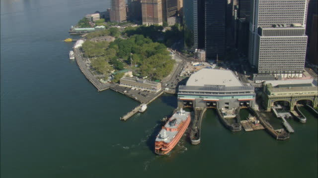 aerial staten island ferry docks at whitehall terminal / manhattan, new york city, new york, usa - ferry terminal stock videos & royalty-free footage