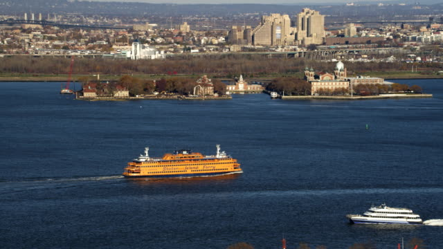 Staten Island Ferry near Ellis Island with New Jersey shoreline in background. Shot in 2011.