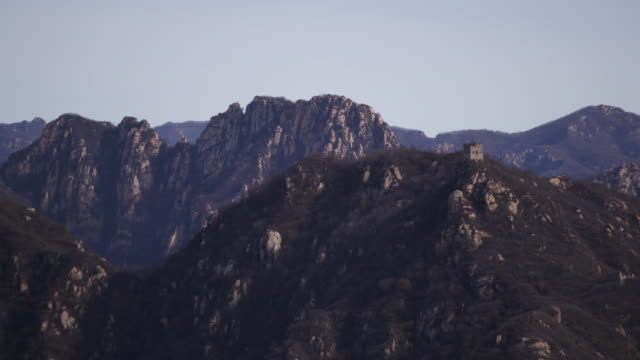 static aerial drone shot of the mountain range ridgeline from the great wall of china in beijing china - aerial or drone pov or scenics or nature or cityscape stock-videos und b-roll-filmmaterial