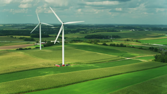 static aerial shot of cornfields and wind turbines in southern wisconsin - turbine stock videos & royalty-free footage
