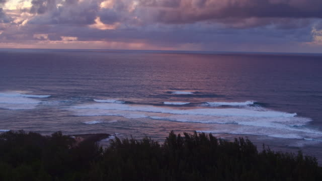 static aerial shot of the ocean during sunset - kahuku stock videos & royalty-free footage