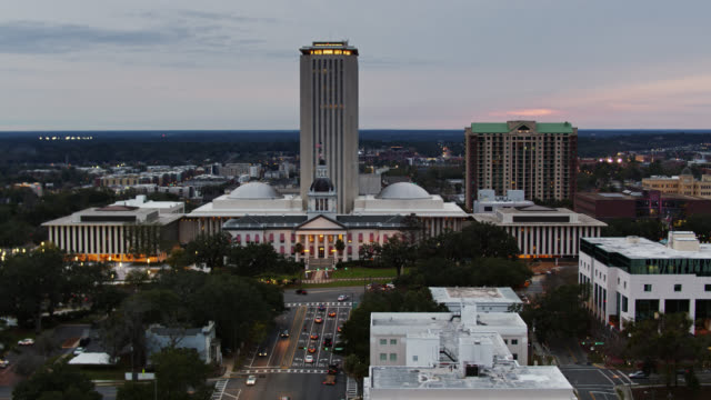 static aerial shot of the old and new florida state capitols at dusk - florida us state stock videos & royalty-free footage