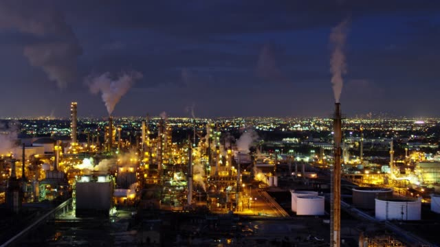 static aerial view of oil refinery at night - refinery stock videos & royalty-free footage
